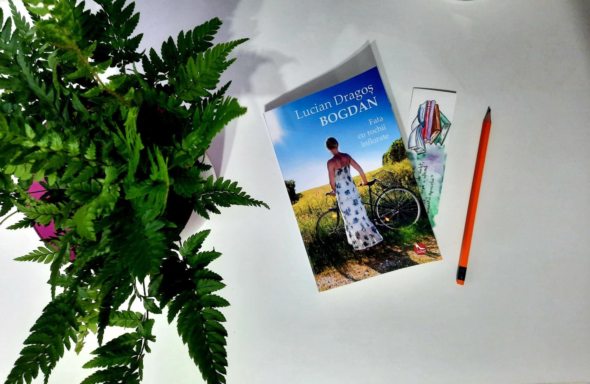 """Ar putea fi o imagine cu carte, natură, copac şi text care spune """"Lucian DragoÈ BOGDAN Fata cu rochii înflorate"""""""
